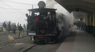 Stock Video Footage of A steam train  in India leaves the station
