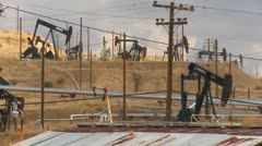 Oil & gas, forest of  of pump-jacks, heavy industry Stock Footage