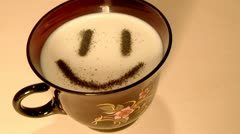 Smilie,character in a cup of milk. Stock Footage