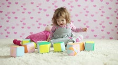 Happy baby girl playing on the carpet - stock footage