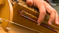 Hurdy gurdy being played by man,  #5 close up Stock Footage