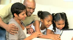 Young Ethnic Family Using Wireless Tablet  Stock Footage