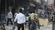 Builders in busy street, Delhi India Stock Footage