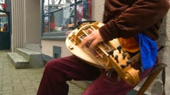 Hurdy gurdy being played by man, #2 Stock Footage