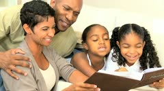 African American Family with Photograph Album Stock Footage