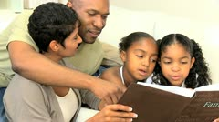 Young Ethnic Family with Photograph Album Stock Footage