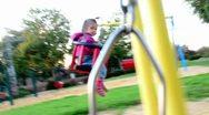 Girl swings on a swing 02 Stock Footage