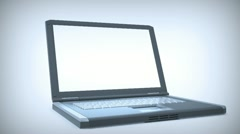 Zoom into an opening laptop computer - stock footage