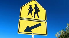 Children Crossing Sign on Blue Sky Stock Footage
