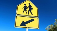 Stock Video Footage of Children Crossing Sign on Blue Sky