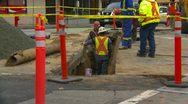 Construction, workers in trench with traffic, lots of safety Stock Footage