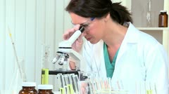 Science Research Assistant Using Microscope - stock footage