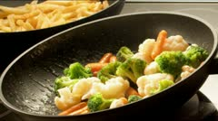 Frying Vegetables in Slow Motion - stock footage