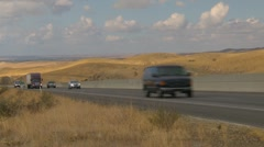 transportation, TN trucks up steep hill through frame - stock footage