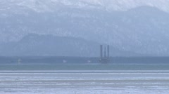 Jack-up Rig on Kachemak Bay - zoom out to scenic Stock Footage