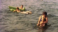 Family in the Water At the Beach Circa 1960 (Vintage Film Home Movie) 1277 Stock Footage
