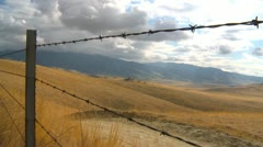 San Joaquin valley hill view, southern California scenery, autumn with barb wire Stock Footage