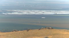 Agriculture, high above San Joaquin valley lagoons Stock Footage