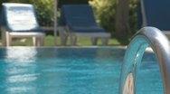 Stock Video Footage of Man is swimming in swimmingpool