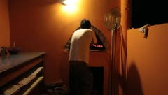 Man preparing pizza in brick oven(HD)c Stock Footage
