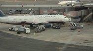 U.S  Airways plane parked at gate(HD)c Stock Footage