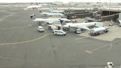 Airplanes parked at their gates at airport(HD)c Stock Footage