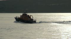 Lifeboat Moving Fast and Creating Wash Stock Footage
