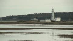 Lighthouse at Hurst Spit, Hampshire, UK Stock Footage