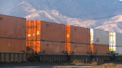 Railroad, container train, stacker and piggback through yard Stock Footage