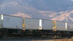 Railroad, container train through yard end of train Stock Footage