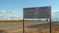 sign, Warning US Air Force Installation, ID required English and Spanish - stock footage