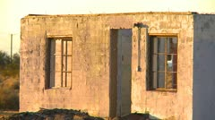 Abandoned house, roofless and long forgotten, sunset Stock Footage