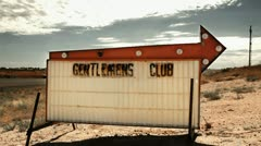 Sleazy Gentlemans Club Sign in Desert - Strip Club Show, Strippers Stock Footage
