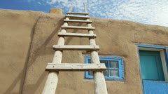 Wooden Ladder Against Adobe Building at Taos Pueblo in New Mexico Stock Footage