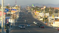 Barstow Main street, lots of advertisement signs with traffic, long Stock Footage