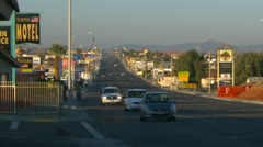 Barstow Main street, lots of advertisement signs with traffic, medium Stock Footage