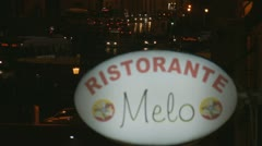 Rack focus traffic to Italian restaurant sign Stock Footage