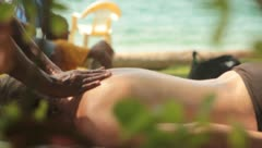 Getting a massage at the beach Stock Footage