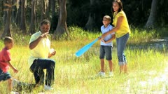 Active Ethnic Family Playing Baseball in Park Stock Footage