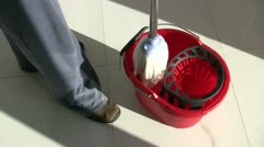 Cleaning at home with mop Stock Footage