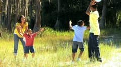 Young Ethnic Family Paying Ball in the Park - stock footage