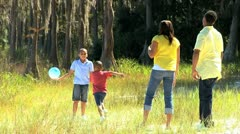 Young Ethnic Family Playing Ball in the Park - stock footage