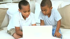 African American Boys with Laptop on Sofa Stock Footage