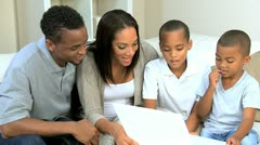 Little Ethnic Boys Using Laptop Computer with Parents - stock footage