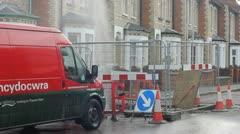 Water leak in the road Stock Footage