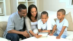 Young Family Using Wireless Tablet for Online Video Chat Stock Footage