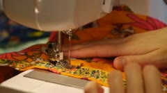 Seamstress. Staple fabric on the sewing machine - stock footage
