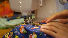 Seamstress. Staple fabric on the sewing machine Stock Footage