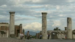 A couple explore Pompeii ruins Stock Footage