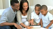 Young Family at Home Using a Wireless Tablet Stock Footage